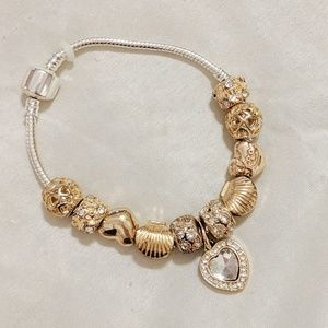 Jewelry - Silver and gold charm bracelet